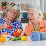 caregiver-and-senior-woman-preparing-meal-copy-1